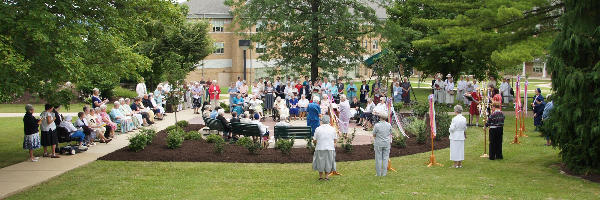 Sisters in prayer outside at Caritas Christi